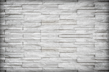 Gray slate wall stone background or texture.