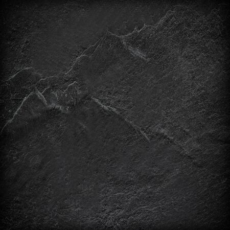 Donkergrijze zwarte leiachtergrond of textuur.