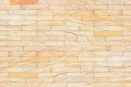 Texture of the stone wall for background,Sandstone wall background,Pattern of Sandstone Brick Wall Surface 版權商用圖片 - 127111012