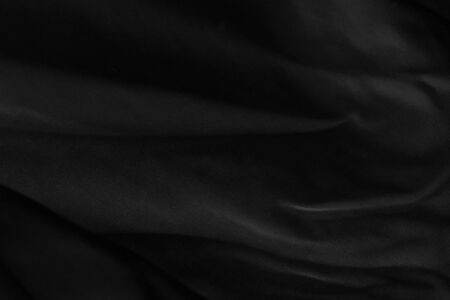 Black fabric sheets background or texture.