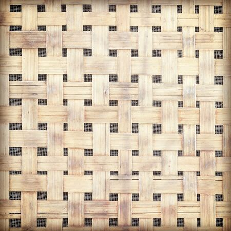 Old and dirty bamboo weave wall vintage retro style background and texture retro style.