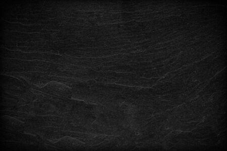 Dunkelgrauer schwarzer Schieferhintergrund oder -beschaffenheit.