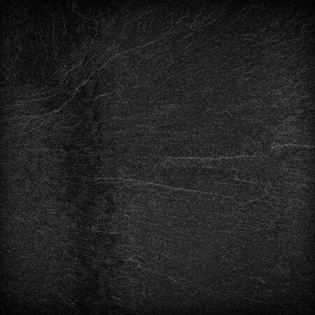 ダークグレーの黒いスレートの背景またはテクスチャ。