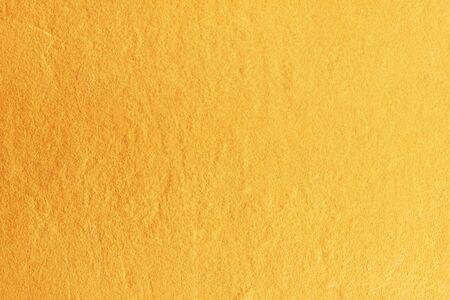 Gold paint on cement wall texture. golden texture background Reklamní fotografie