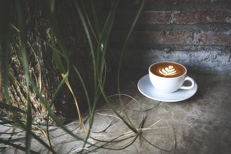 Cup of coffee latte art on grey background. Beautiful foam, place for text. Stok Fotoğraf - 147579991