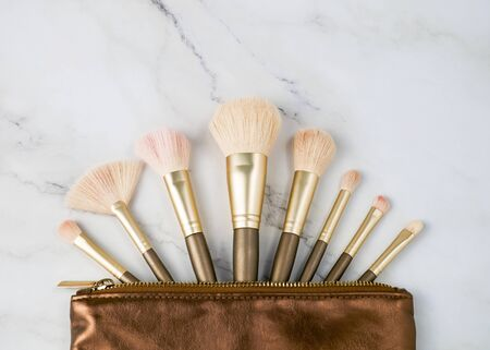 Make up brush lie on a marble background.