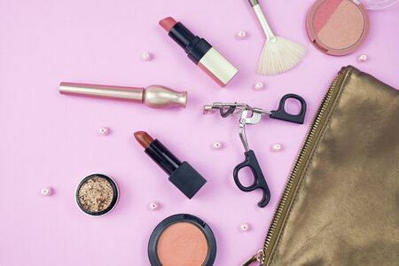 Makeup brushes and tools, make-up products set isolated on pink background. Imagens