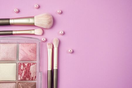 Makeup brushes and tools, make-up products set isolated on white background. Imagens