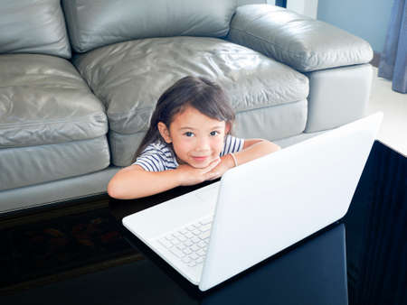 A Girl studying lesson online  from home on laptop. social distance during quarantine, self-isolation, online education concept. Stok Fotoğraf