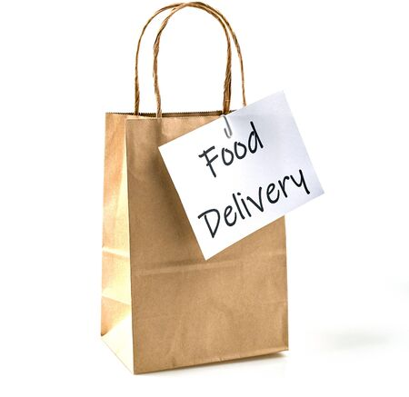 Delivery of food grocery brown bag on the doorstep for protect Corona virus spreading of safety. Precaution measures against COVID-19, paper bag delivered without contact.