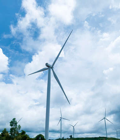 Renewable energy wind turbines power generator in nature on the mountain.