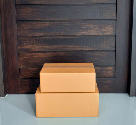 A parcel box placed at the front of the door. Quarantine, contactless delivery during a pandemic covid. Stay at home, Online shopping.