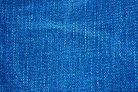 close up of blue slub jean or slub denim fabric , the slub is difference size of thread woven together