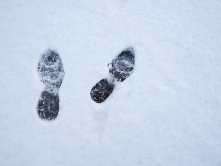 trecking: Footprints in fresh snow background. Top view.