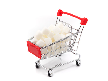 Trolly with sugar on white background. Healthy lifestyle concept. Stock Photo
