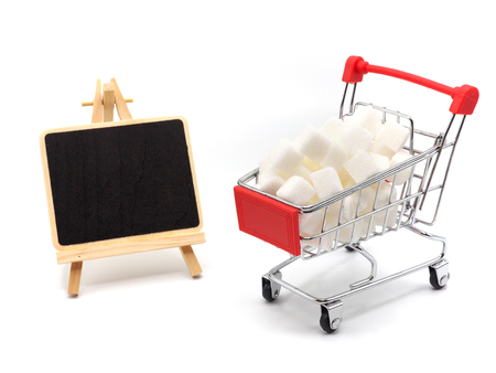 Trolly with sugar and small blackboard,  Healthy lifestyle concept.