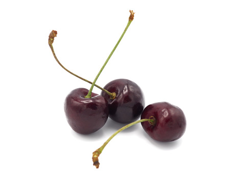 Fresh sweet cherry in shopping cart or trolly isolated on white background. Stock Photo
