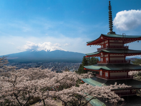 temple tower: Mt. Fuji with cherry blossom in Japan. Stock Photo