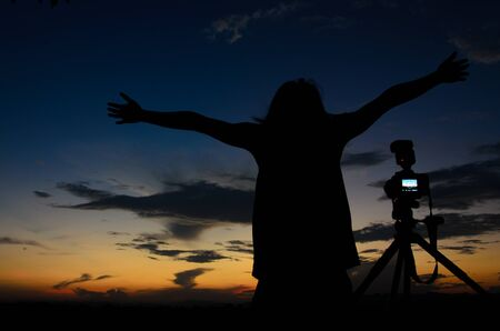 elysium: happy feeling man in silhouette Stock Photo
