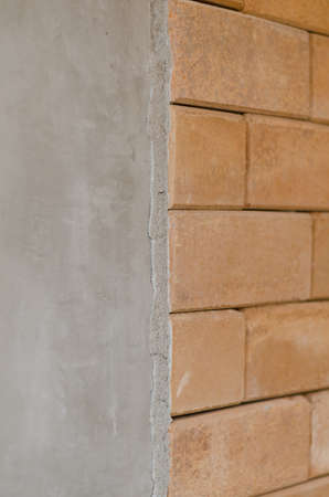 differ: difference of concrete wall and red brick wall