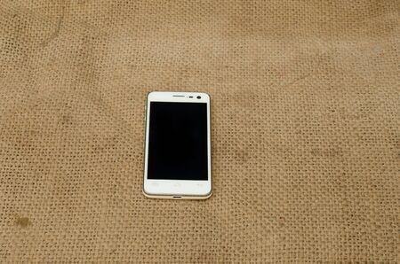 sackcloth: small phone on sackcloth