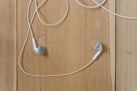 earphone: earphone on wooden background Stock Photo