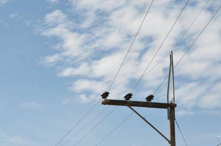 light transmission: electric pole with blue sky