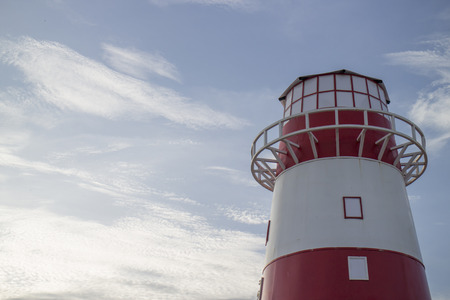 light house: red and white light house Stock Photo