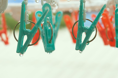 clothes pegs: vintage clothespin on rainyday with selective focus on peg