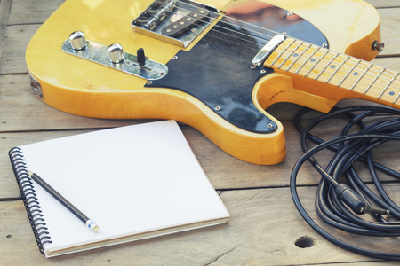 Telecaster with notepad on wood table Stock Photo