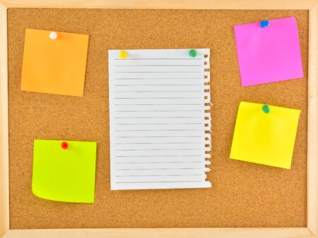 Stick note. Blank notes pinned on corkboard Stock Photo