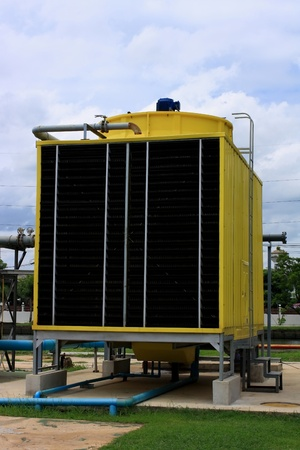 Yellow cooling tower in plant photo