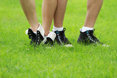 lacing sneakers: Feet on the green grass