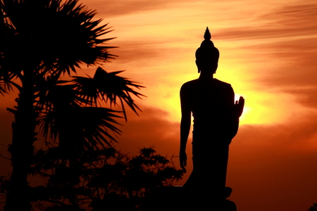 black   shadow: black shadow of big Buddha statue with evening sunset background