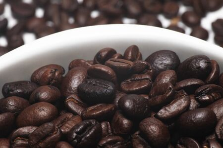 coffe beans in awhite cup