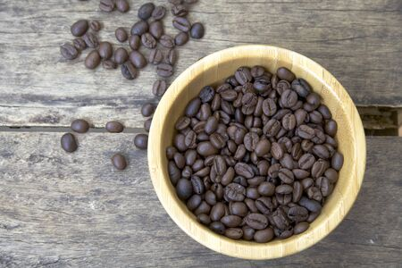 Coffee beans in a wooden cup Stock Photo