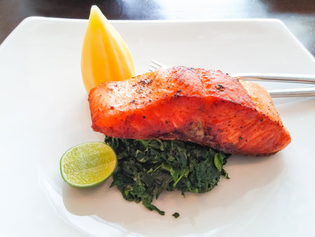 Salmon steak with spinach,mashed potato and lamon