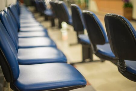 Waiting room blue chairs in hospital