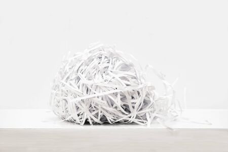 Shredded paper ball on white background