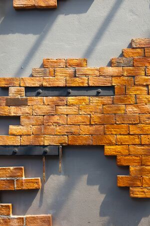 Wall design with brick, concrete and steel