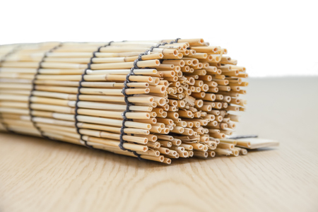 Reed rolls on wood background