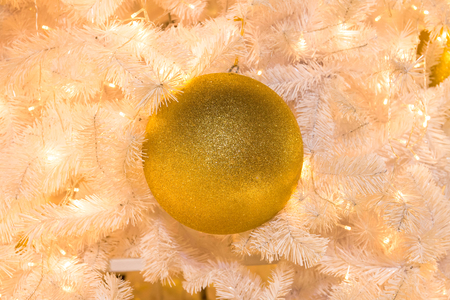 Gold ball on christmas tree Stock Photo