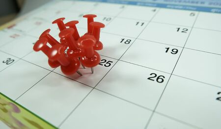 Number 25 day pinning on calendar with Red color pin thumbtack, concept for busy day