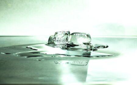 Melting ice cube. Stock Photo - 18938086