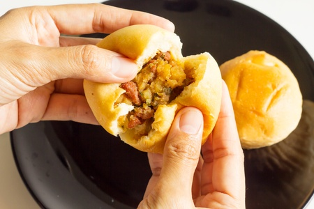 Eating bread stuffing  Stock Photo