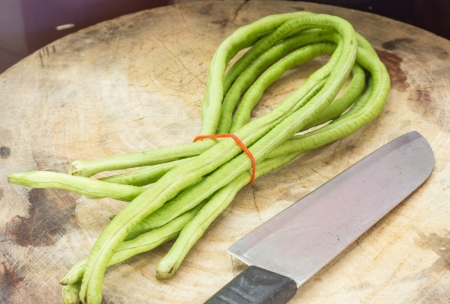 long bean: Long bean and knife  Stock Photo