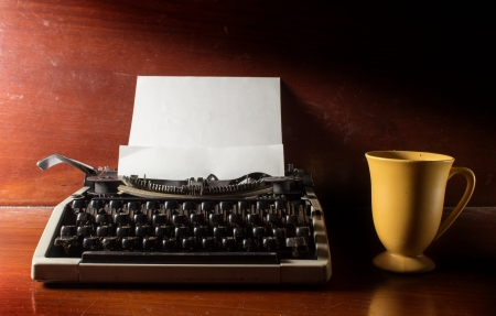 Typewriter with coffee cup  photo