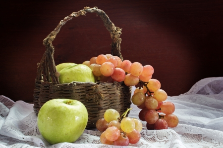 Apples and grapes with old basket  photo