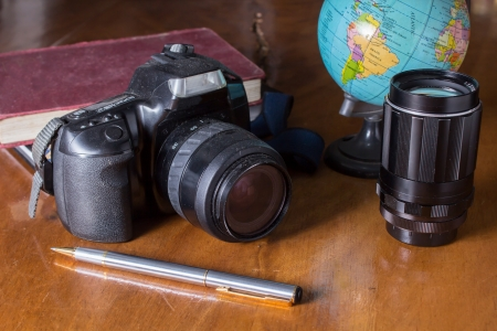 Plan to travel,camera with globe  photo