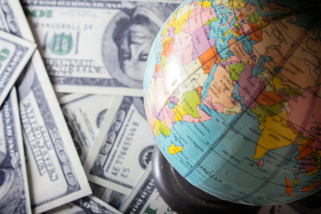World currency, money and globe  photo
